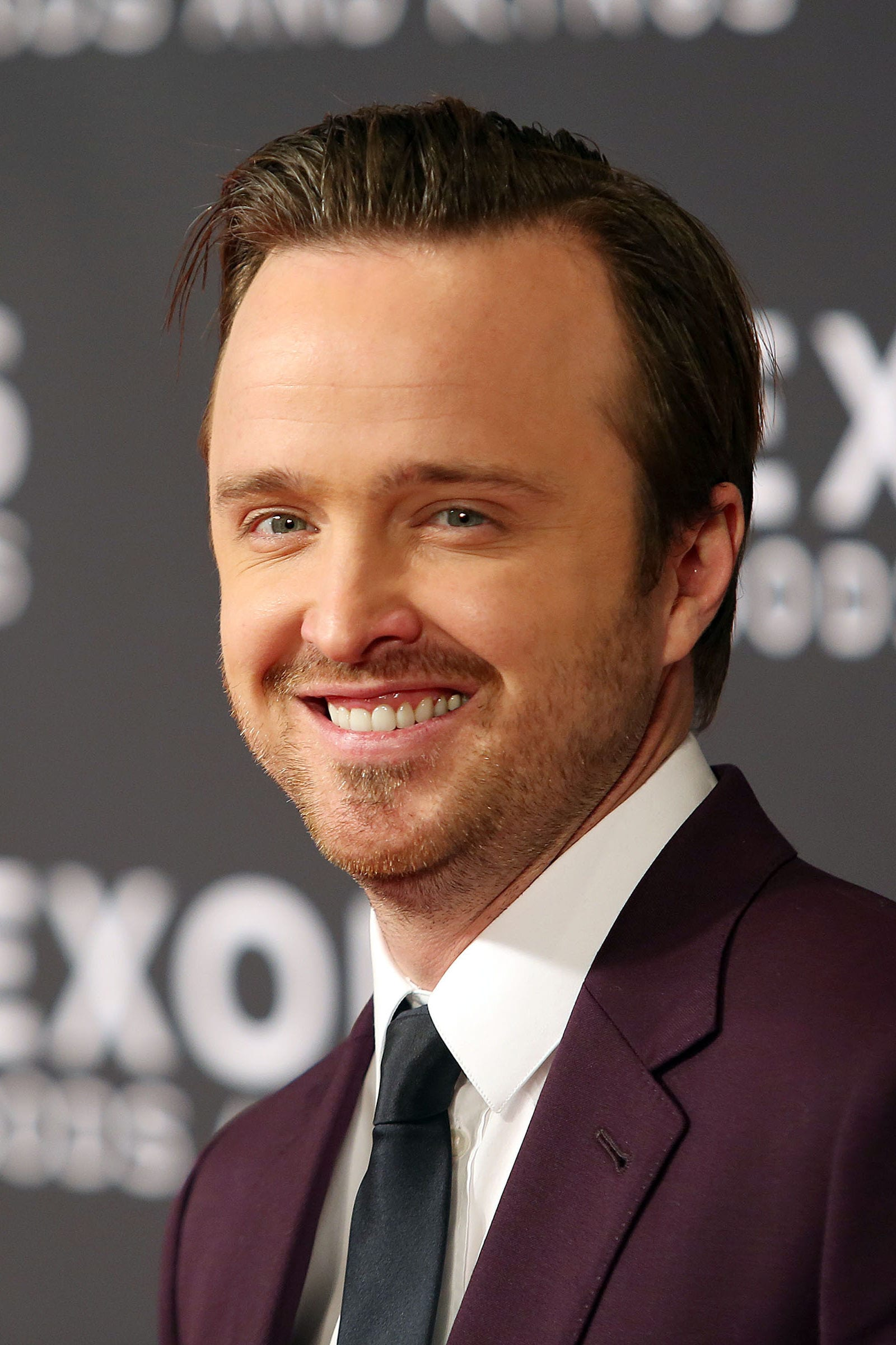 Aaron Paul swiped back side part hairstyle by Krista Kennell