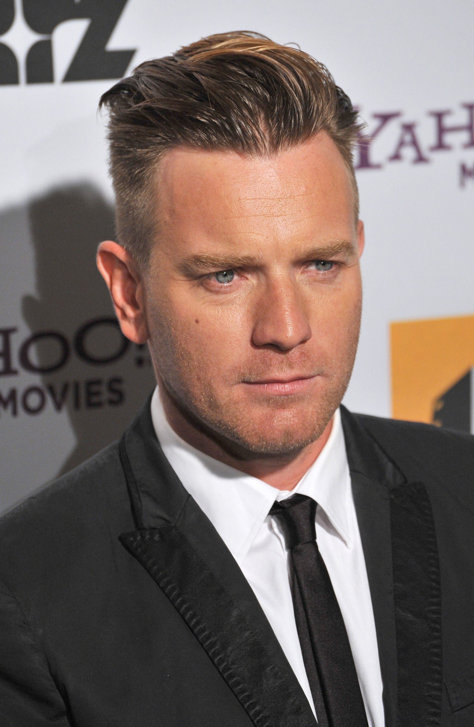 Ewan McGregor slicked back undercut by Jaguar PS